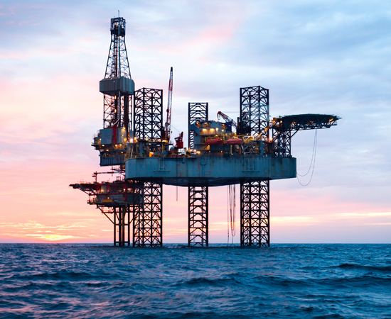 Oil platform in the ocean during sunset