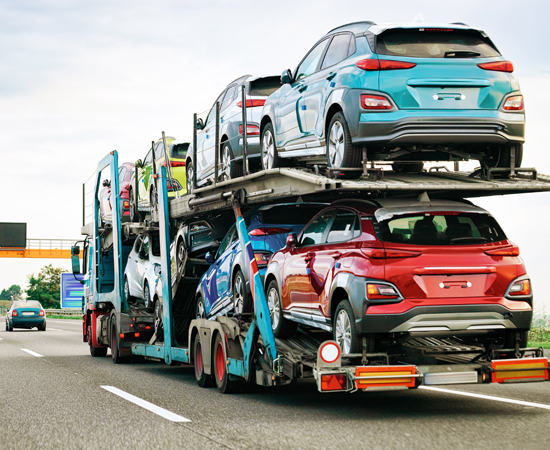 Car carrier truck carrying 8 cars on the highway