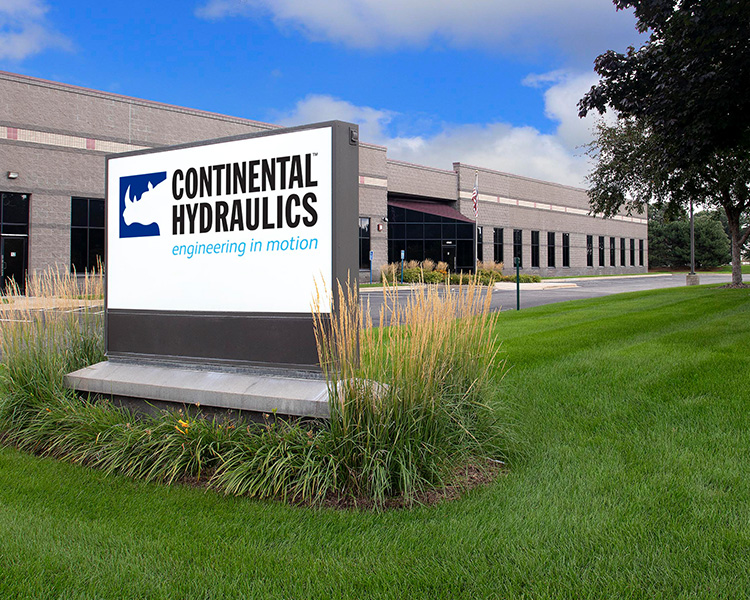 Daytime image of Continental Hydraulic's brick and mortar facility with company logo on billboard